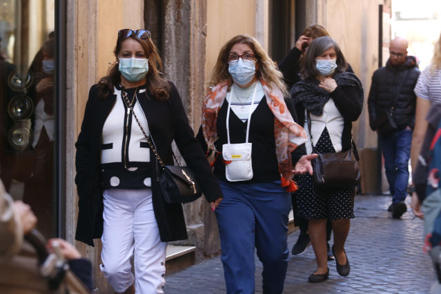 Tourists wearing masks around the Trevi Fountains in Rome after a coronavirus outbreak in northern Italy. (Samantha Zucchi /Insidefoto/Sipa USA)
