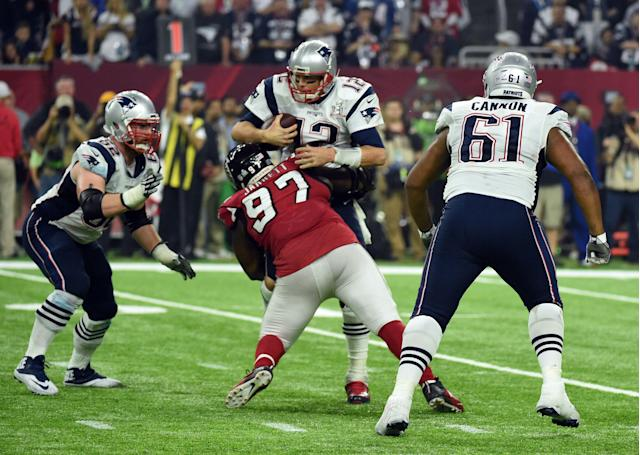 Tom Brady #12 of the New England Patriots is sacked by Grady Jarrett #97 of the Atlanta Falcons in the fourth quarter during Super Bowl 51 at NRG Stadium on February 5, 2017 in Houston, Texas. / AFP / Timothy A. CLARY (Photo credit should read TIMOTHY A. CLARY/AFP via Getty Images)
