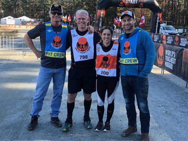 PHOTO: Kristen Reed and another competitor with their 'pit crew' at the World's Toughest Mudder competition. (Tough Mudder)