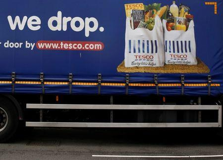 Part of a slogan is pictured on the side of a Tesco supermarket delivery truck in New Malden southwest London