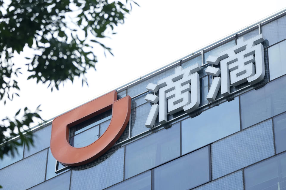 The Didi logo is seen at the top of its headquarters building in Beijing on July 16, 2021. Didi Global Inc. on Friday, July 30, 2021 denied a report by The Wall Street Journal that the ride-hailing service was considering buying back its U.S.-traded shares after its June market debut was disrupted by Chinese government orders to overhaul data security. (AP Photo/Ng Han Guan)