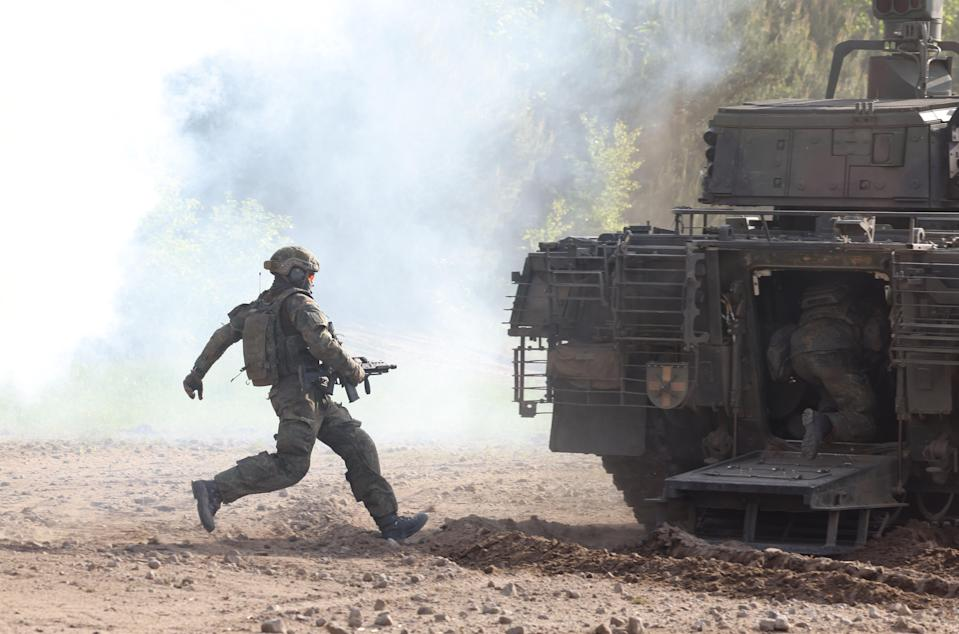 A Bundeswehr soldier runs towards a Puma mechanized infantry combat vehicle during a demonstration of capabilities by the Panzerlehrbrigade 9 tank training brigade on June 02, 2021 in Munster, Germany. Germany has steadily increased its defense spending in recent years, to a record EUR 53 billion slated for 2021 (Getty Images)