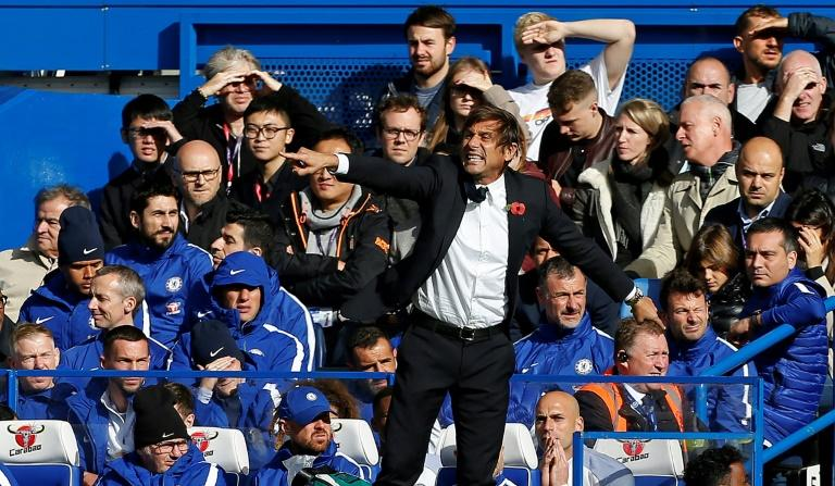 Chelsea's head coach Antonio Conte shouts instructions to his players from the touchline during their match against Watford at Stamford Bridge in London on October 21, 2017