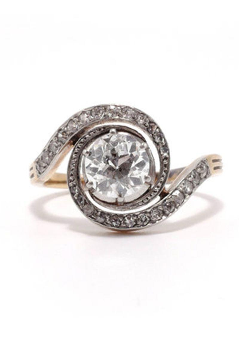 "<p><strong><em>Ashley Zhang</em></strong> <em>The Antoinette Ring Old European Cut Diamond Engagement Ring, circa the 1900s, $10,300, <a href=""https://ashleyzhangjewelry.com/vintage/antoinette"" rel=""nofollow noopener"" target=""_blank"" data-ylk=""slk:ashleyzhangjewelry.com"" class=""link rapid-noclick-resp"">ashleyzhangjewelry.com</a></em></p><p><a class=""link rapid-noclick-resp"" href=""https://ashleyzhangjewelry.com/vintage/antoinette"" rel=""nofollow noopener"" target=""_blank"" data-ylk=""slk:SHOP"">SHOP</a></p>"