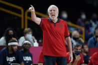 United States head coach Greg Popovich directs his team during a men's basketball preliminary round game against the Czech Republic at the 2020 Summer Olympics, Saturday, July 31, 2021, in Saitama, Japan. (AP Photo/Charlie Neibergall)