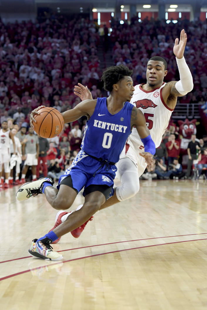Kentucky guard Ashton Hagans (0) drives past Arkansas defender Reggie Chaney (35) during the second half of an NCAA college basketball game, Saturday, Jan. 18, 2020, in Fayetteville, Ark. (AP Photo/Michael Woods)