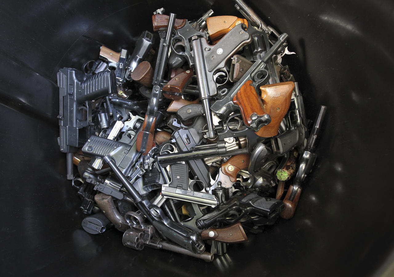 Hand guns that were turned in by their owners are seen in a trash bin at a gun buyback held by the Los Angeles Police Department following the mass shooting at Sandy Hook Elementary School in Connecticut, in Los Angeles, California, December 26, 2012. The program normally occurs in May but Los Angeles mayor Antonio Villaraigosa accelerated the schedule in response to the December 14 shooting that left 20 children and six adults dead, along with the gunman, and caused a national outcry against gun violence. People can anonymously trade in their guns, no questions asked, for $200 grocery store gift cards for automatic weapons and $100 gift cards for shotguns, handguns and rifles.  REUTERS/David McNew (UNITED STATES - Tags: SOCIETY)