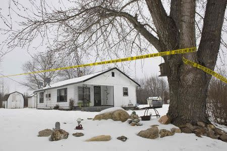 Police tape surrounds one of the crime scenes where gunman, Joseph Jesse Aldridge, killed seven people on Thursday night in Tyrone, Missouri February 27, 2015.    REUTERS/Kate Munsch