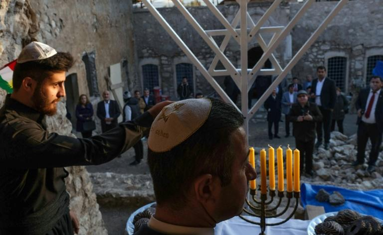 Around 20 people gathered for what organiser Ranj Cohen said was the first celebration of Hanukkah in Iraqi Kurdistan (AFP Photo/SAFIN HAMED)