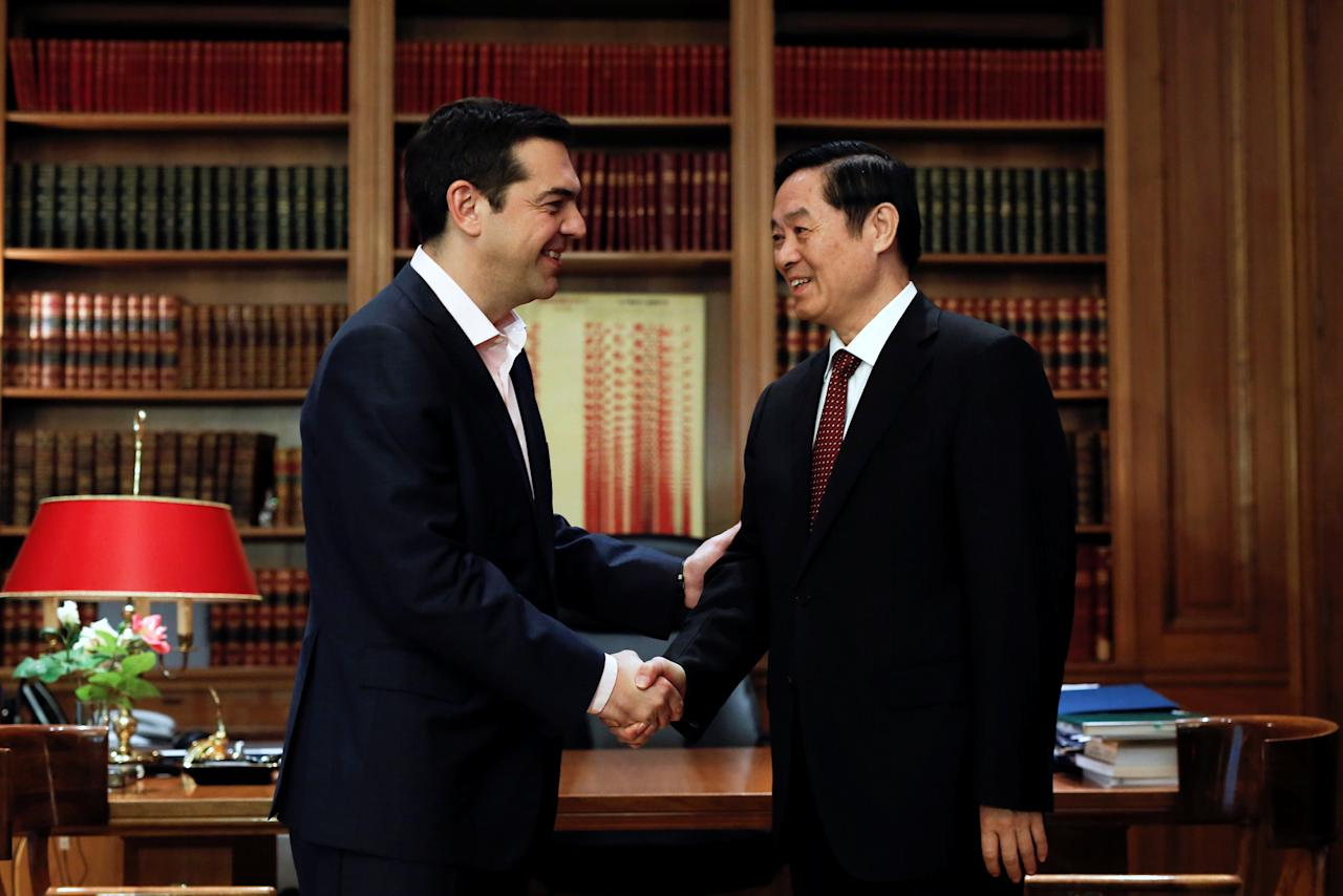 Greek Prime Minister Alexis Tsipras welcomes a member of the Politburo of the Communist Party of China, Liu Qibao, at his office at the Maximos Mansion in Athens, Greece, April 27, 2017. REUTERS/Alkis Konstantinidis