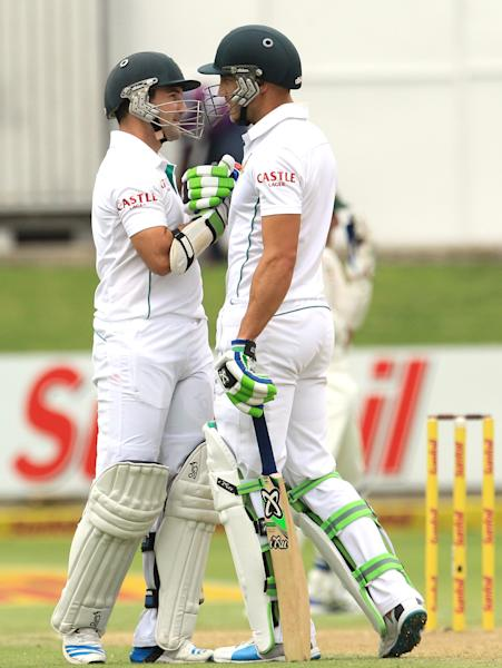 South Africa's batsman Dean Elgar, left, shakes hand with teammate Faf du Plessis, right, after reaching his half century on the first day of their 2nd cricket test match at St George's Park in Port Elizabeth, South Africa, Thursday, Feb. 20, 2014. (AP Photo/ Themba Hadebe)