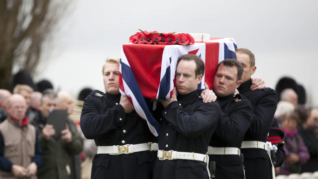 The casket of a World War One soldier is carried during a ceremony at the H.A.C. cemetery in Ecoust-St-Mein, France on Tuesday, April 23, 2013.Almost 100 years after they were killed in action, Lieutenant John Harold Pritchard and Private Christopher Douglas Elphick were re-interred with full military honors in a private ceremony. Lieutenant Pritchard was killed in action on May 15, 1917 during an enemy attack near Bullecourt, France and his remains were found in a field near the site in 2009. His body was eventually identified by a silver bracelet with his name engraved on it. Private Elphick was born in Dulwich, South London in 1889. He was killed in action on May 15, 1917 during an enemy attack near Bullecourt, France and his remains were found in a field near the site in 2009. His body was eventually identified by a signet ring bearing his initials. (AP Photo/Virginia Mayo)