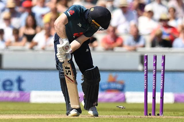Captain Eoin Morgan bowled for a duck as England's early batting collapsed against Australia. (AFP Photo/Oli SCARFF)