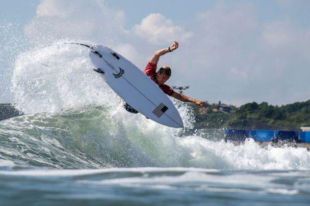 PHOTO: Kolohe Andino, of the United States, rides a wave during the first round of the men's surfing competition at the 2020 Summer Olympics, Sunday, July 25, 2021, at Tsurigasaki beach in Ichinomiya, Japan. (Olivier Morin/AP Photo)