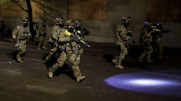 PHOTO: Federal officers advance on retreating demonstrators after an illegal assembly was declared during a Black Lives Matter protest at the Mark O. Hatfield United States Courthouse, July 29, 2020, in Portland, Ore. (Marcio Jose Sanchez/AP)