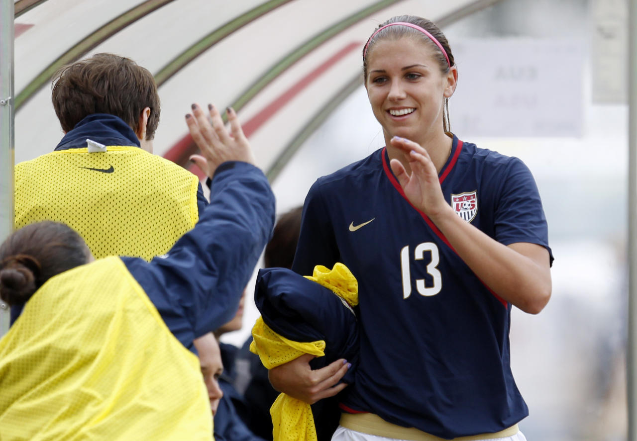 U.S. player Alex Morgan is greeted by teammates on the bench after being substituted during their Algarve Cup women's soccer match with Finland Monday, March 7 2011, in Quarteira, Portugal. Morgan scored twice.