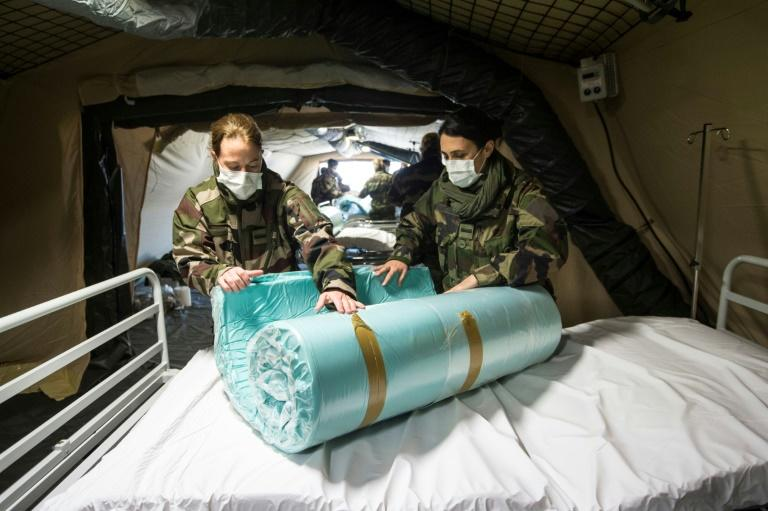 French soldiers have been setting up field hospitals to help overstretched health workers in several northern French cities