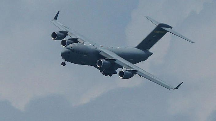 A C-17 performs at an air show in Singapore, 2012
