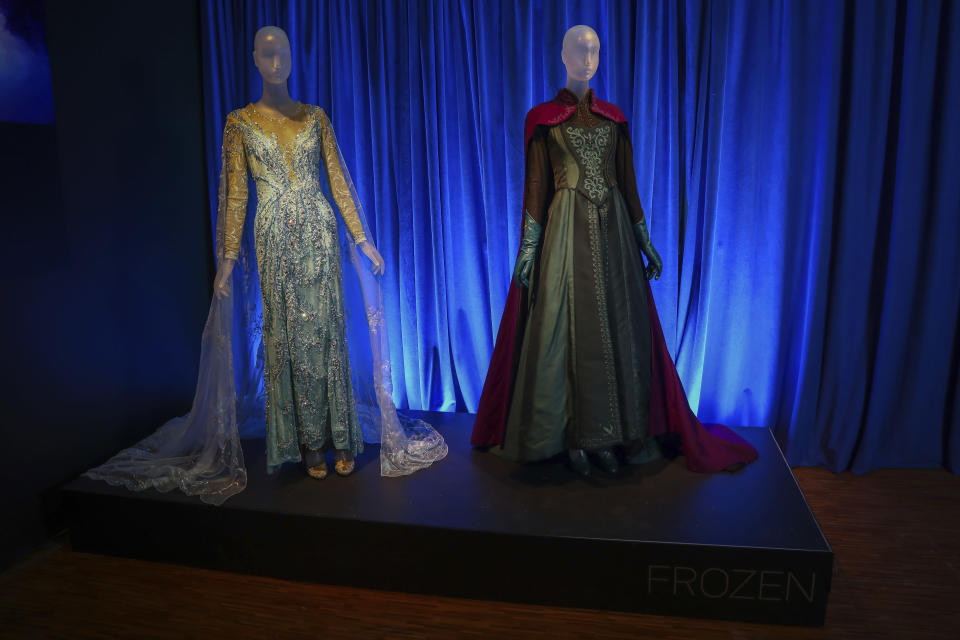 """Costumes from the Broadway musical """"Frozen"""" are displayed at the """"Showstoppers! Spectacular Costumes from Stage & Screen"""" exhibit, benefitting the Costume Industry Coalition Recovery Fund, in Times Square on Monday, Aug. 2, 2021, in New York. (Photo by Andy Kropa/Invision/AP)"""