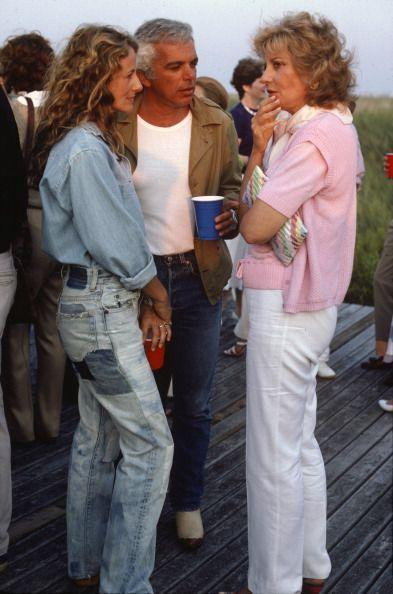 """<p>Ricky and Ralph Lauren chat with Barbara Walters during a party at their Hamptons house. Ricky wears stonewashed jeans, """"which the manufacturers say are washed with rocks to soften and fade the fabric,"""" according to the <em><a href=""""http://www.nytimes.com/1982/08/17/style/notes-on-fashion.html"""" rel=""""nofollow noopener"""" target=""""_blank"""" data-ylk=""""slk:Times"""" class=""""link rapid-noclick-resp"""">Times</a>.</em> They also said it was a trend so popular it """"revived the denim market"""" in the early '80s.</p>"""