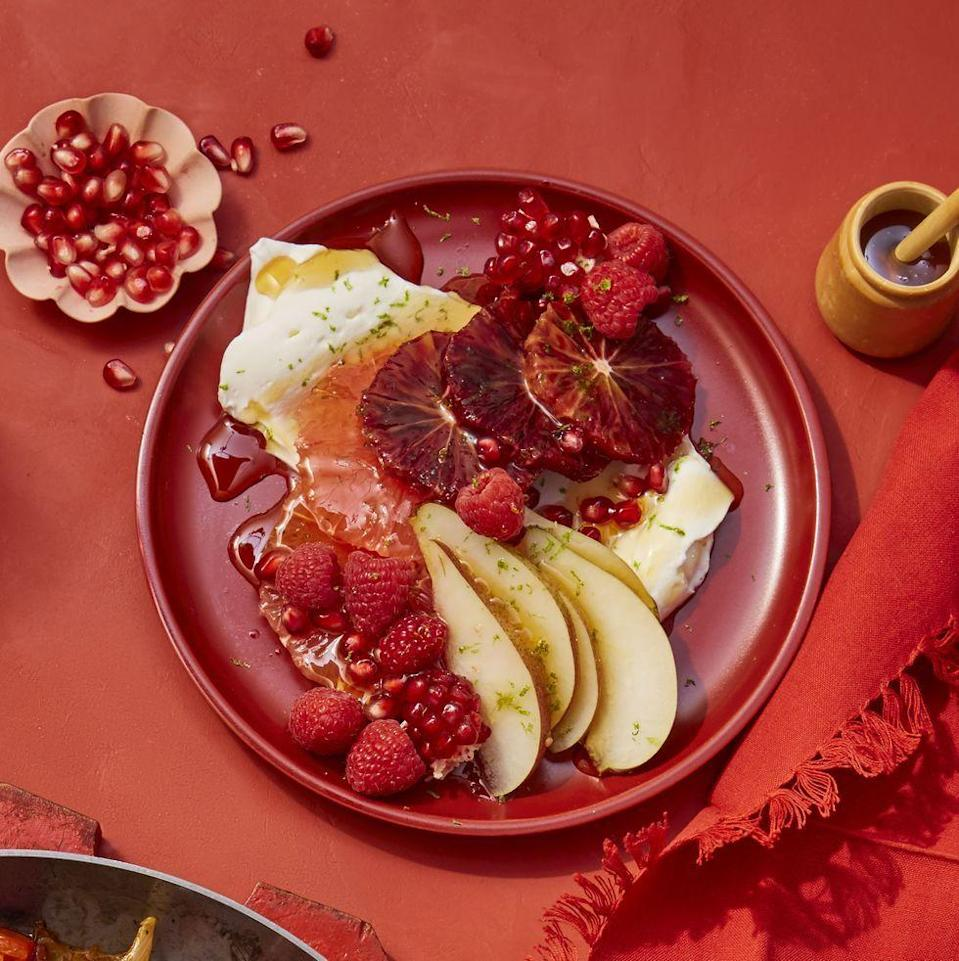 """<p>The greek yogurt and honey perfectly complement the tart citrus in this salad from the vitamin C-filled blood oranges and grapefruit. <br></p><p><em><a href=""""https://www.womansday.com/food-recipes/food-drinks/a25836475/red-citrus-salad-with-berries-pears-and-pomegranates-recipe/"""" rel=""""nofollow noopener"""" target=""""_blank"""" data-ylk=""""slk:Get the Red Citrus Salad with Berries, Pears and Pomegranates recipe."""" class=""""link rapid-noclick-resp"""">Get the Red Citrus Salad with Berries, Pears and Pomegranates recipe.</a></em></p>"""