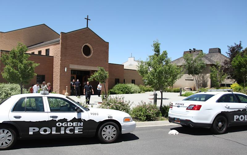 Police are outside St. James Catholic Church in Ogden, Utah, Sunday June 16, 2013 after a man was shot in the back of the head during mass at the church. The suspect, Charles Richard Jennings Jr., 35, was captured Sunday afternoon in nearby Box Elder County after fleeing in a stolen pickup truck, investigators said. (AP Photo/Standard-Examiner, Benjamin Zack) TV OUT; MANDATORY CREDIT MBO (BENJAMIN ZACK/Standard-Examiner) MANDATORY CREDIT, LOCAL TV OUT
