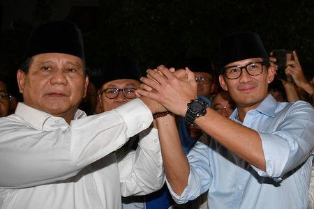 Gerindra Party Chairperson Prabowo Subianto (L) and Jakarta Deputy Governor Sandiaga Uno announce their bid in the 2019 presidential elections in Jakarta, Indonesia August 9, 2018 in this photo taken by Antara Foto. Picture taken August 9, 2018.  Antara Foto/Sigid Kurniawan/ via REUTERS