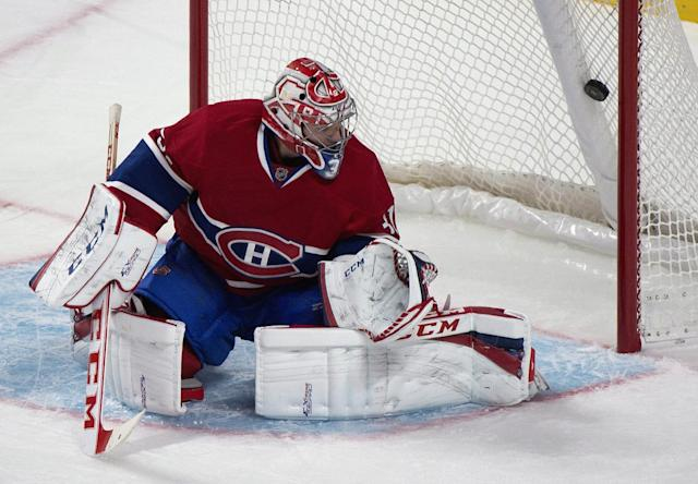 Montreal Canadiens goaltender Carey Price is scored on by Boston Bruins' Nick Johnson during the first period of an NHL preseason hockey game in Montreal, Monday, Sept. 16, 2013. (AP Photo/The Canadian Press, Graham Hughes)