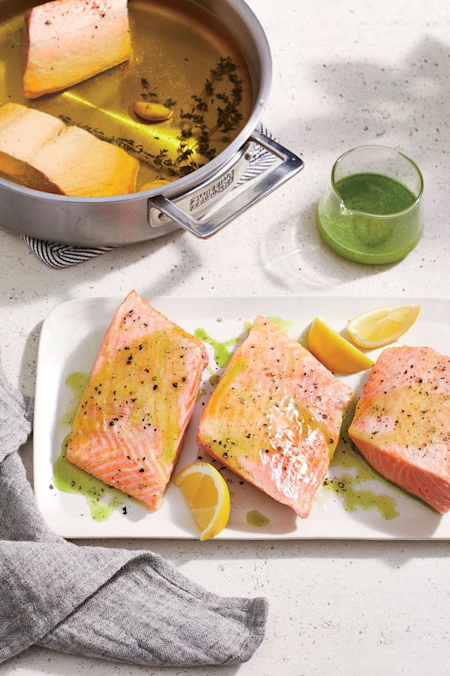 """<p>Achieve sous vide-like results without all the gadgetry. Classic olive oil poaching leads to balanced flavors, tender fillets, and some seriously incredible seafood leftovers. Store any remaining <a href=""""https://www.coastalliving.com/food/seafood-basics/easy-salmon-recipes"""">salmon</a> in extra herb oil and flake into pastas, eggs, or salad all week long.</p> <ul><li><strong>Recipe: <a href=""""https://www.coastalliving.com/recipe/olive-oil-poached-salmon-herb-oil"""">Olive Oil-poached Salmon with Herb Oil</a></strong></li> </ul>"""