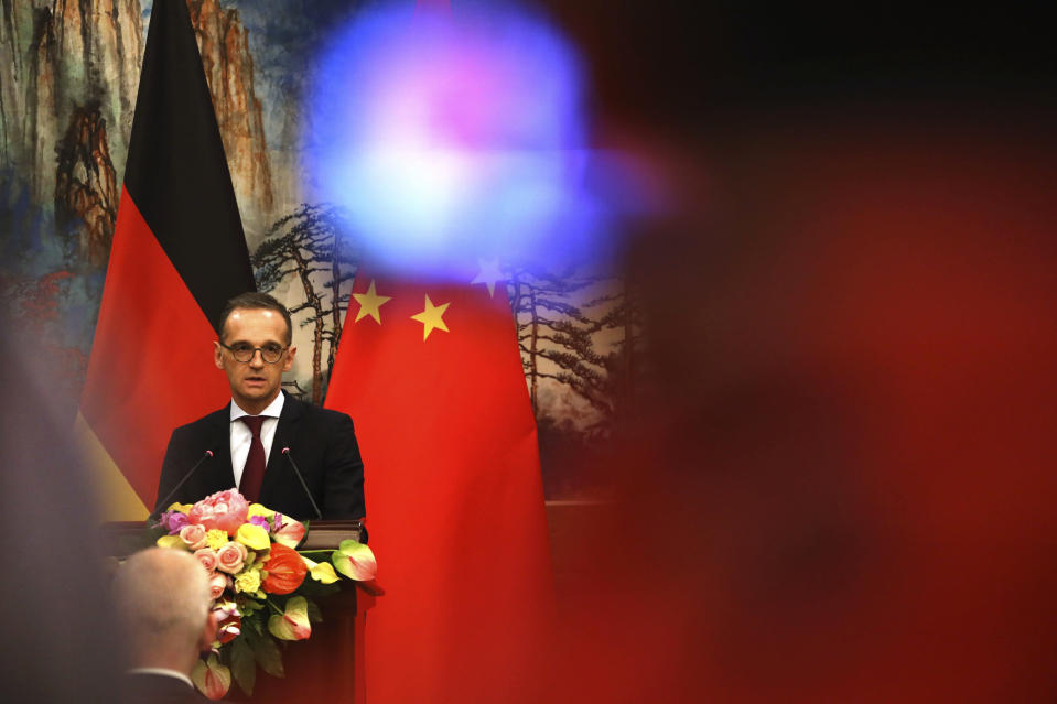 """FILE-In this Nov. 13, 2018 file photo German Foreign Minister Heiko Maas speaks during a joint press conference at the Diaoyutai State Guesthouse in Beijing. China has condemned Germany's decision to suspend its extradition agreement with Hong Kong, accusing Berlin of a """"serious breach of international law."""" (AP Photo/Ng Han Guan)"""