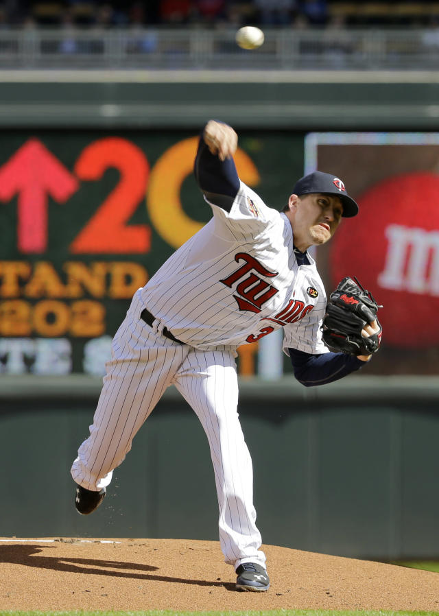 Minnesota Twins starting pitcher Kevin Correia delivers to the Oakland Athletics during the first inning of a home opener MLB American League baseball game in Minneapolis, Monday, April 7, 2014. (AP Photo/Ann Heisenfelt)
