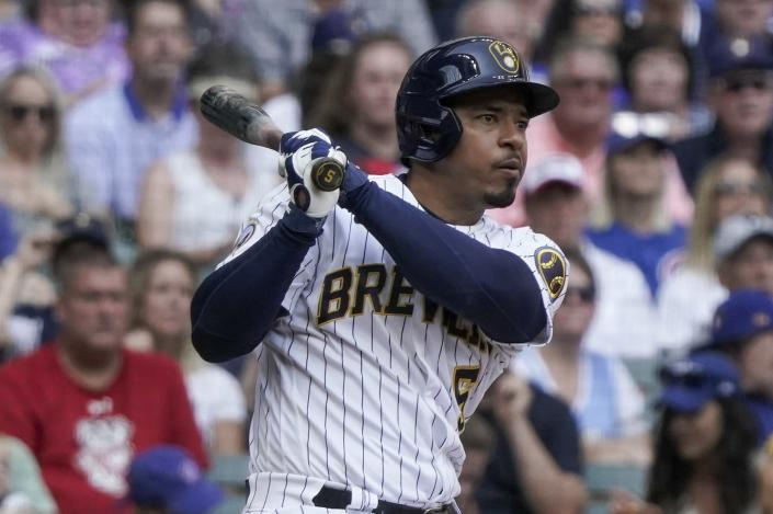Milwaukee Brewers' Eduardo Escobar rhits an RBI double during the fifth inning of a baseball game against the Chicago Cubs Sunday, Sept. 19, 2021, in Milwaukee. (AP Photo/Morry Gash)