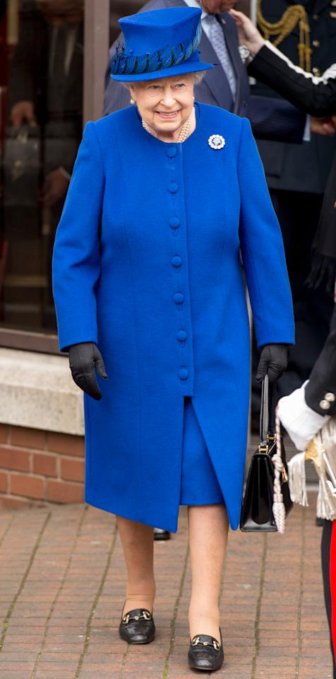 <p>The Queen wore a royal blue coat and matching feathered hat to celebrate the 40th anniversary of The Prince's Trust.</p>