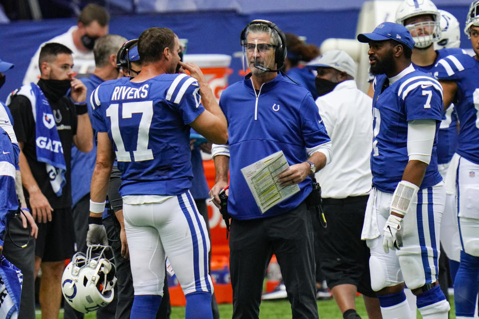 Indianapolis Colts head coach Frank Reich talks with quarterback Philip Rivers (17) in the first half of an NFL football game against the New York Jets in Indianapolis, Sunday, Sept. 27, 2020. (AP Photo/AJ Mast)