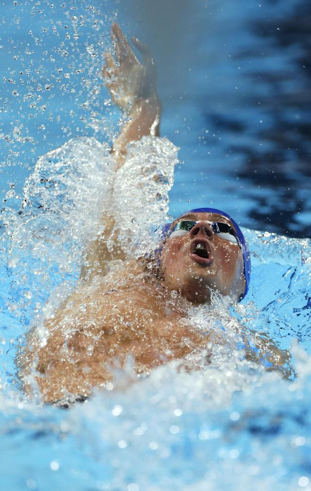 Ryan Lochte swims in a men's 200-meter backstroke semifinal at the U.S. Olympic swimming trials on Friday, June 29, 2012, in Omaha, Neb. (AP Photo/Mark Humphrey)