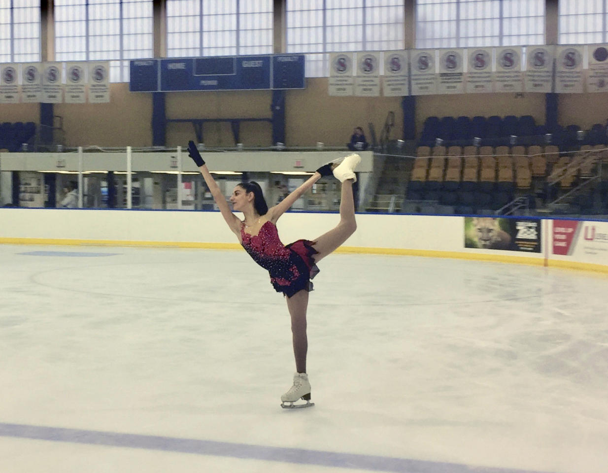 """In this June 3, 2018, photo provided by Championship Figure Skating Camp, skater Isabella Melendez practices a spiral at Essex County Codey Arena in West Orange, N.J. Rosie Tovi has a better idea. The figure skating coach believes _ and she has many supporters throughout the ice world _ an emphasis on """"happy and healthy"""" should take precedence over turning the sport into gymnastics in a rink. The longtime coach and choreographer calls it a holistic approach. """"Holistic is a perfect word, because it is the whole,"""" says Tovi, who will be launching her Championship Figure Skating Camp at the Essex County Codey Arena in West Orange on June 25. (Rosie Tovi/Championship Figure Skating Camp via AP)"""