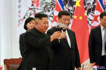 North Korean leader Kim Jong Un and Chinese President Xi Jinping raise a toast in Beijing, China