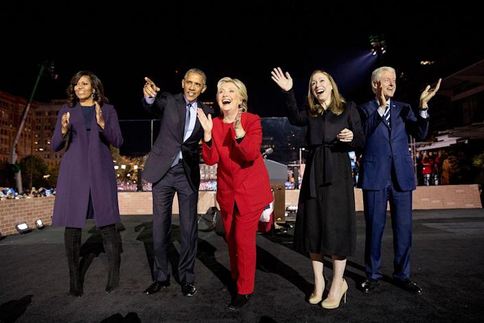 <p>Democratic presidential candidate Hillary Clinton, center, is joined on stage by first lady Michelle Obama, left, President Barack Obama, second from left, Chelsea Clinton, second from right, and former President Bill Clinton, right, after speaking at a rally at Independence Mall in Philadelphia, Monday, Nov. 7, 2016. (Photo: Andrew Harnik/AP) </p>