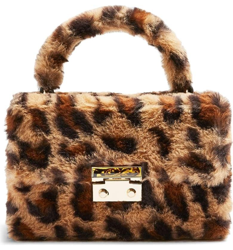 "<p>You'll never want to stop touching this <a href=""https://www.popsugar.com/buy/Topshop-Fizz-Leopard-Print-Faux-Fur-Top-Handle-Bag-497696?p_name=Topshop%20Fizz%20Leopard%20Print%20Faux%20Fur%20Top-Handle%20Bag&retailer=shop.nordstrom.com&pid=497696&price=48&evar1=fab%3Aus&evar9=46284514&evar98=https%3A%2F%2Fwww.popsugar.com%2Ffashion%2Fphoto-gallery%2F46284514%2Fimage%2F46712719%2FTopshop-Fizz-Leopard-Print-Faux-Fur-Top-Handle-Bag&list1=shopping%2Cnordstrom%2Csummer%20fashion%2Caffordable%20shopping&prop13=api&pdata=1"" rel=""nofollow"" data-shoppable-link=""1"" target=""_blank"" class=""ga-track"" data-ga-category=""Related"" data-ga-label=""https://shop.nordstrom.com/s/topshop-fizz-leopard-print-faux-fur-top-handle-bag/5446167?origin=category-personalizedsort&amp;breadcrumb=Home%2FWomen%2FNew%20Arrivals&amp;color=leopard"" data-ga-action=""In-Line Links"">Topshop Fizz Leopard Print Faux Fur Top-Handle Bag</a> ($48).</p>"