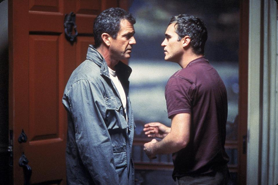 """Mel GIbson (left) and Joaquin Phoenix are farm dudes dealing with an alien invasion in """"Signs."""""""