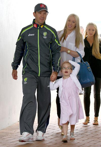 Australian cricket player Ricky Ponting walks with his wife Rianna and family to attend a press conference to announce his retirement from international cricket on November 29, 2012 in Perth, Australia.  (Photo by Paul Kane/Getty Images)