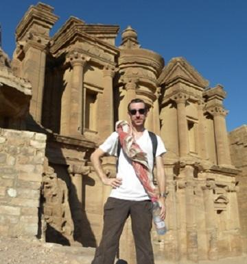 UC doctoral student Christian Cloke in front of the Monastery of Ed Deir at Petra.