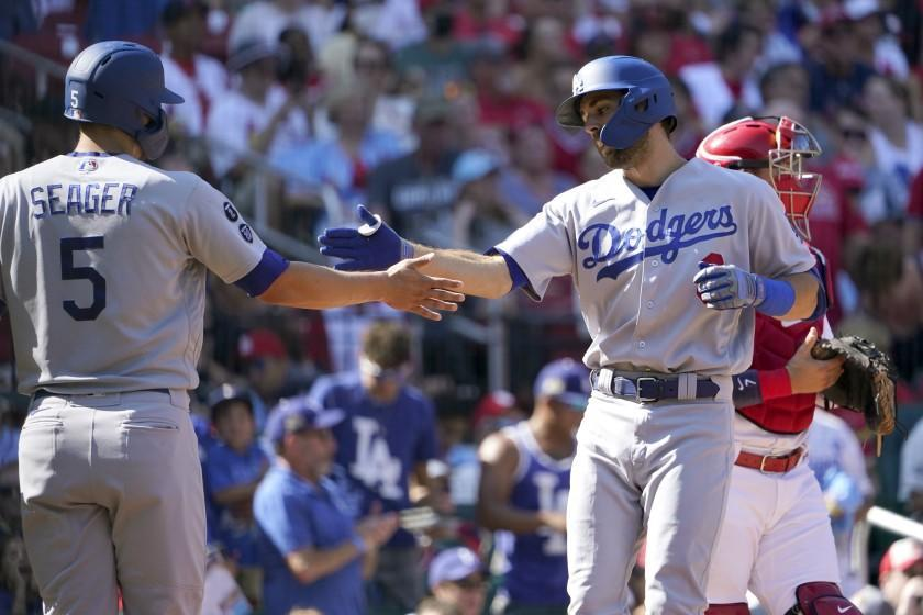 Los Angeles Dodgers' Chris Taylor, right, is congratulated by teammate Corey Seager (5) after hitting a two-run home run during the first inning of a baseball game against the St. Louis CardinalsMonday, Sept. 6, 2021, in St. Louis. (AP Photo/Jeff Roberson)
