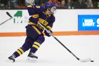 Minnesota State forward Parker Tuomie (6) skates with the puck against the Bowling Green during an NCAA college hockey game, Saturday, Dec. 15, 2018, in Bowling Green, Ohio. Parker Tuomie and the Minnesota State hockey team had their chase for the program's first NCAA championship ended abruptly a year ago. Tuomie, a native of Germany, now plays professionally in Berlin. (AP Photo/Rick Osentoski, File)