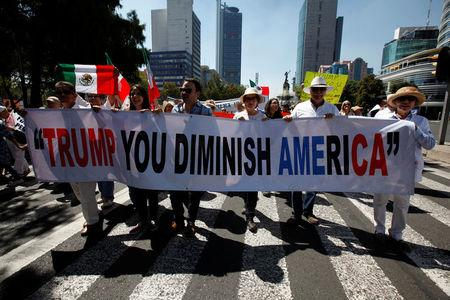 Demonstrators hold a banner during a march to protest against U.S. President Donald Trump's proposed border wall, and to call for unity, in Mexico City, Mexico, February 12, 2017. REUTERS/Jose Luis Gonzalez