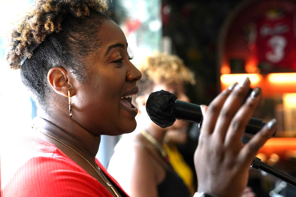 Jamiris Williams sings with the David Ensemble during the Gospel Brunch at the Red Rooster restaurant in the Overtown neighborhood, Sunday, June 6, 2021, in Miami. (AP Photo/Lynne Sladky)