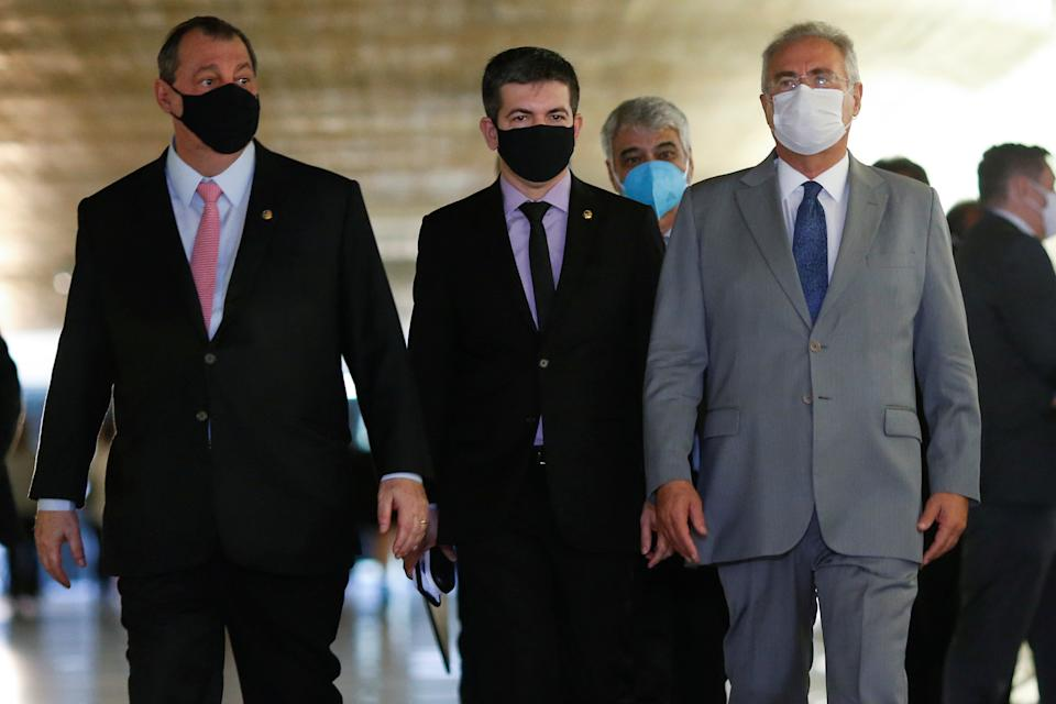 Brazilian Senators Omar Aziz, Randolfe Rodrigues and Renan Calheiros walk after a meeting of the Parliamentary Inquiry Committee(CPI) to investigate government actions and management during the coronavirus disease (COVID-19) pandemic, at the Federal Senate in Brasilia, Brazil April 27, 2021. REUTERS/Adriano Machado