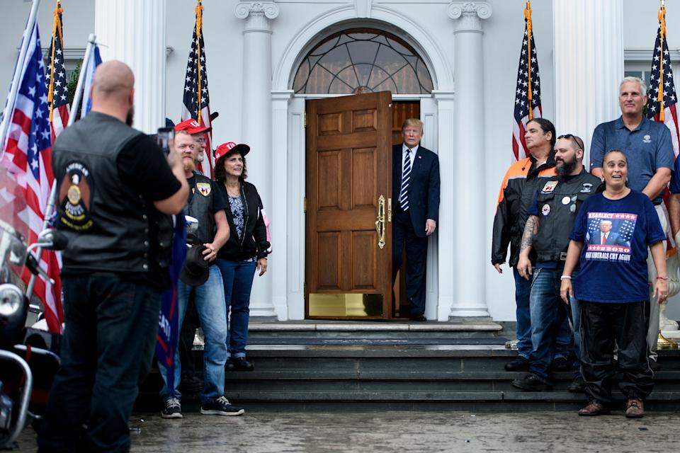 US President Donald Trump greets supporters during a Bikers for Trump event at the Trump National Golf Club August 11, 2018 in Bedminster, New Jersey. - Trump welcomed approximately 180 bikers made up of Veterans, law enforcement, supporters and members from the Bikers for Trump New Jersey chapter. (Photo by Brendan Smialowski / AFP)        (Photo credit should read BRENDAN SMIALOWSKI/AFP via Getty Images)