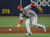 FILE - In this June 25, 2021, file photo, Los Angeles Angels third baseman Anthony Rendon reaches for a ball that went for an infield base hit by Tampa Bay Rays ' Kevin Kiermaier during the sixth inning of a baseball game in St. Petersburg, Fla. Rendon will have season-ending hip surgery, finishing off an injury-plagued second season in Southern California. The club made the announcement before Wednesday's game at Texas.(AP Photo/Steve Nesius, File)
