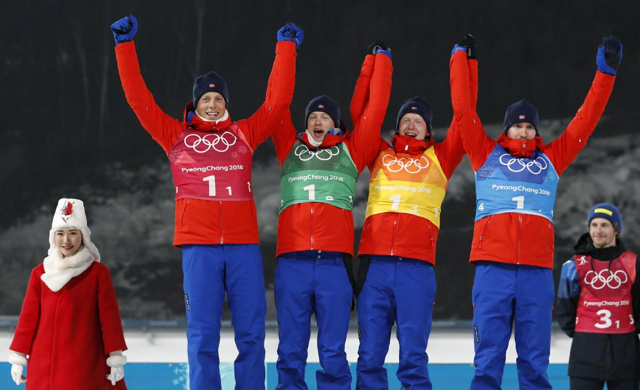 Biathlon - Pyeongchang 2018 Winter Olympics - Men's 4x7.5 km Relay Final - Alpensia Biathlon Centre - Pyeongchang, South Korea - February 23, 2018 - Silver medalists Lars Helge Birkeland, Tarjei Boe, Johannes Thingnes Boe and Emil Hegle Svendsen of Norway celebrate during the victory ceremony. REUTERS/Murad Sezer